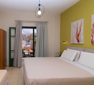 Studio at Lemonia Accommodations with double and single bed and terrace with garden view.