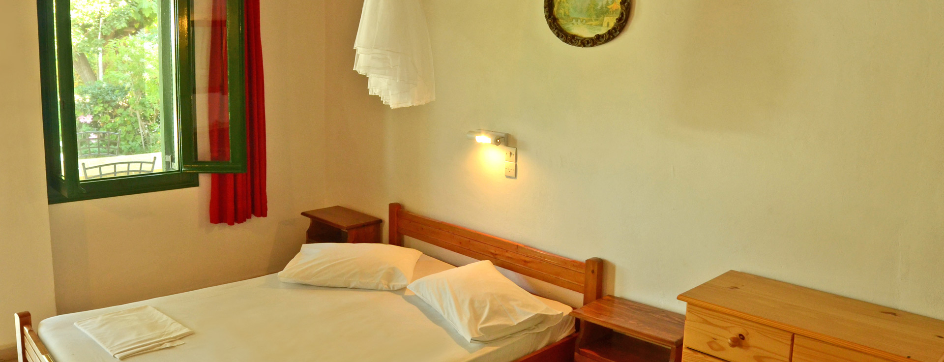 Apartment with double bed at Lemonia Accommodations.