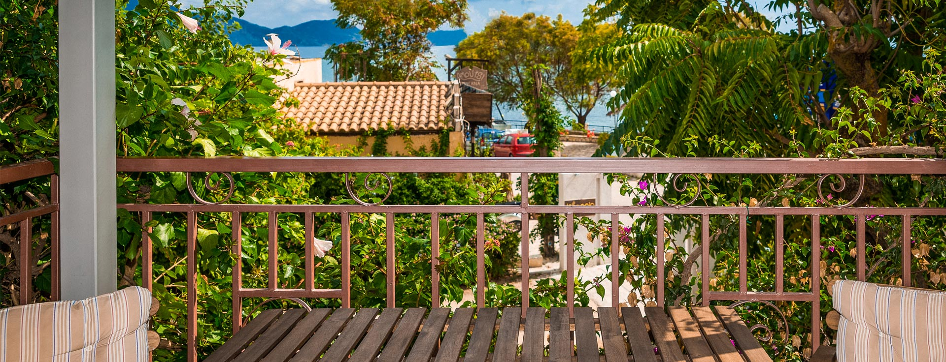 Balcony with sea view at Lemonia accommodations.