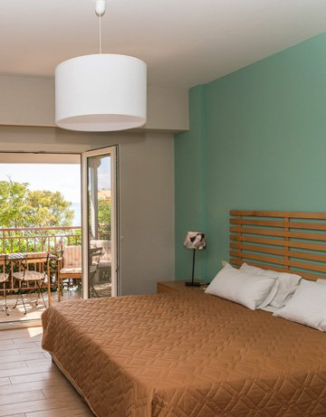 Apartment at Lemonia Accommodations with double and single bed and terrace with garden view.