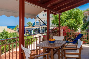 Terrace with sea view at Lemonia accommodations.